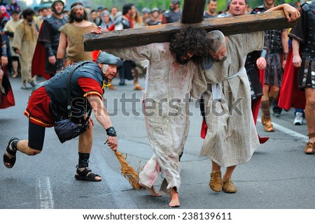 GALATI, ROMANIA - APRIL 16: Staging of Jesus road on the mountain Calavary in Galati, Romania on 16 April 2014 - stock photo
