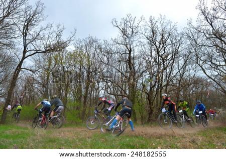 "GALATI, ROMANIA - APRIL 05: Unknown racers on the competition of the mountain bike ""XC Garboavele 2013"" on APRIL 05, 2014 in Galati, Romania - stock photo"
