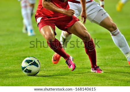 GALATI, ROMANIA - MAY 28: Unknown football players performs during the soccer game Romanian Cup Timisoreana, Otelul Galati (white)  vs. Dinamo Bucharest (red)  on May 28, 2013 in Galati, Romania - stock photo