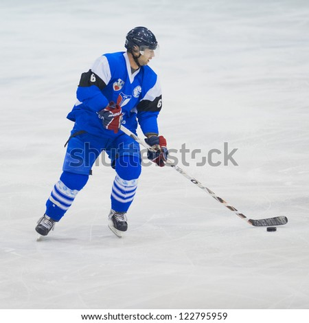 GALATI, ROMANIA - NOVEMBER 17: Unidentified hockey player compete during the CSM Dunarea Galati(blue) vs CSS HSC Csikszereda(white) game, score 10-1, on November 17 , 2012 in Galati, Romania - stock photo