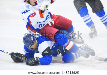GALATI, ROMANIA - NOVEMBER 17: Unidentified hockey players compete during the CSM Dunarea Galati(blue) vs CSS HSC Csikszereda(white) game, score 10-1, on November 17 , 2012 in Galati, Romania - stock photo