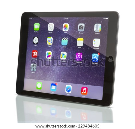 Galati, Romania - October 16, 2014: Apple iPad Air Wi-Fi + Cellular displaying iOS 8 homescreen. iOS 8  operating system designed by Apple Inc. official output 16 October 2014. - stock photo