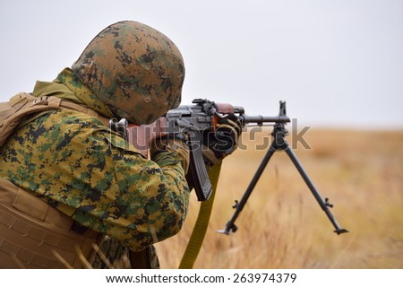 GALATI, ROMANIA - OCTOBER 8: US Marines with semiautomatic rifle on the firing line in Romanian military polygon in the exercise Smardan Danube Express 14 on Galati, Romania, 8 october 2014. - stock photo