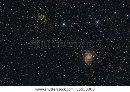 Galaxy and open star cluster - stock photo