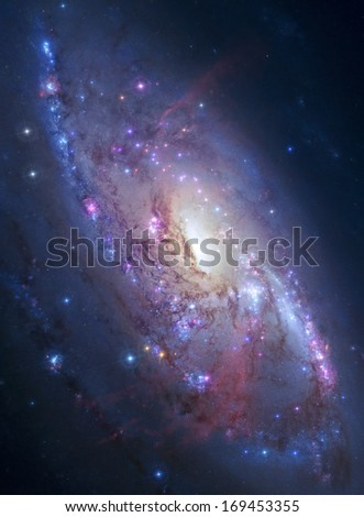 Galaxy M106 lies 23.5 million light-years away, in the constellation Canes Venatici. Elements of this  image has been furnished by NASA - stock photo