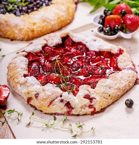 Galeta pie with fresh strawberry and black currant , selective focus - stock photo