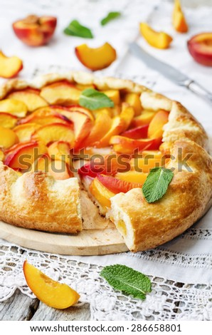 Galette with peaches on a white background. the toning. selective focus