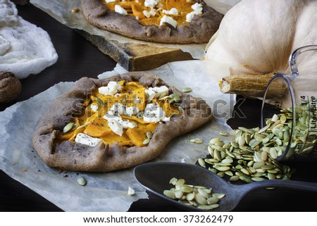 Galette with pumpkin and feta. Selective focus - stock photo