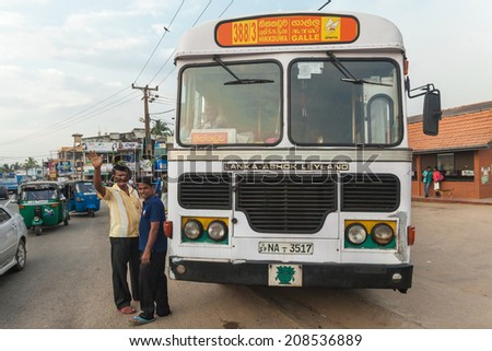 GALLE, SRI LANKA - FEBRUARY 22, 2014: Large public transport bus stopped on street. Buses are the Sri Lankan principal mode of public transport. - stock photo