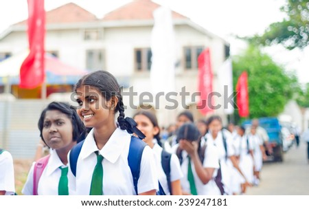 GALLE, SRI LANKA - 26 JAN, 2012: Unidentified pupils walking on the street  during 5 Annual School Festival  in Galle, Sri Lanka - stock photo