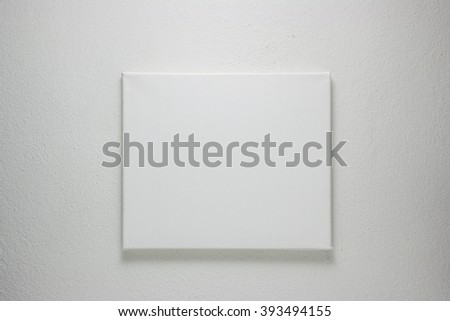 Gallery interior with blank canvas - stock photo