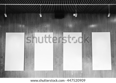 Gallery Interior with empty frames on black and white background. - stock photo