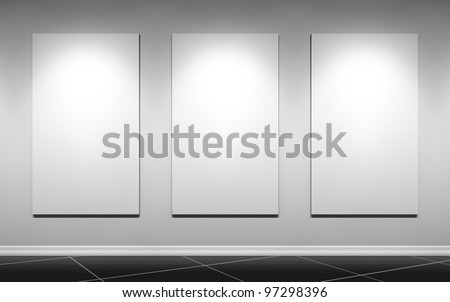 gallery wall with three blank posters - stock photo