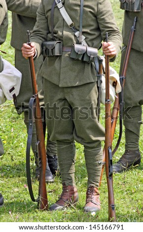 Gallio, Asiago, Vicenza, Italy. 7th july, 2013, Historical representation battle with soldiers of the first world war,soldiers while at rest in the hands of antique rifles - stock photo