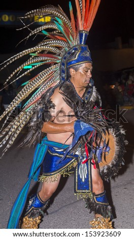 GALLUP , NEW MEXICO - AUG 08 : Aztec dancer with traditional costume participates at the annual Inter-tribal ceremonial night parade on August 08 , 2013 in Gallup New-Mexico