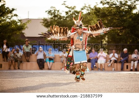GALLUP , NEW MEXICO - AUGUST 04, 2013 : Native Americans with traditional costume participates at the annual Inter-tribal ceremonial night parade on August 04, 2013 in Gallup, New-Mexico, USA - stock photo