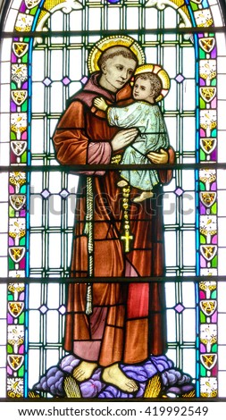 GALLWAY, IRELAND - CIRCA FEBRUARY 2016. St Anthony of Padua, holding the baby Jesus. Church stained glass window in a parish church. - stock photo