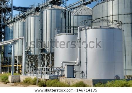 Galvanised Iron grain silos on a farm in Eastern Europe - stock photo
