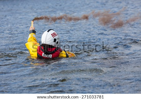 GALWAY, IRELAND - APRIL 12: Irish Coast Guard crew display a water rescue training over Lough Atalia as part of the annual Galway Watersports Show, on April 12, 2015 in Galway, Ireland. - stock photo
