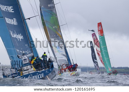 GALWAY, IRELAND - JULY 7: Start of In-port race of 2011-2012 Volvo Ocean Race in Galway, Ireland on July 7, 2012. - stock photo