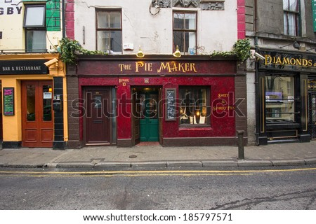 GALWAY, IRELAND - MARCH 31, 2013: Street scene with quaint old shops in Galway, Ireland.  This historic city dates back to the 1100's.  - stock photo