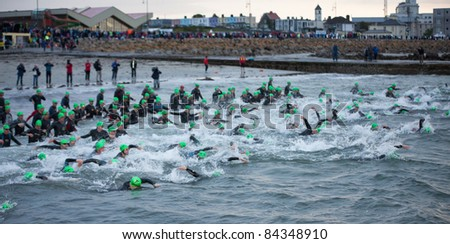 GALWAY, IRELAND - SEPT 4: Athletes start at first Edition of Galway Iron Man Triathlon on September 4, 2011 in Galway, Ireland - stock photo