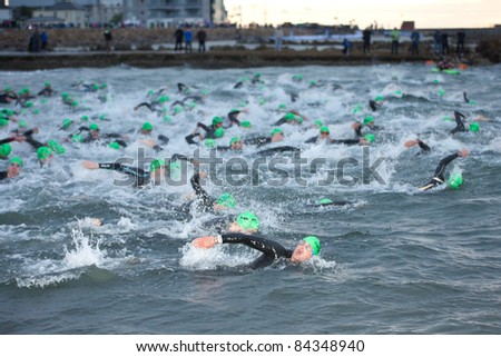 GALWAY, IRELAND - SEPT 4: Athletes swimming at first Edition of Galway Iron Man Triathlon on September 4, 2011 in Galway, Ireland - stock photo