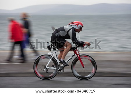 GALWAY, IRELAND - SEPT 4: Corey Dawson (1353) competes at first Edition of Galway Iron Man Triathlon on September 4, 2011 in Galway, Ireland - stock photo