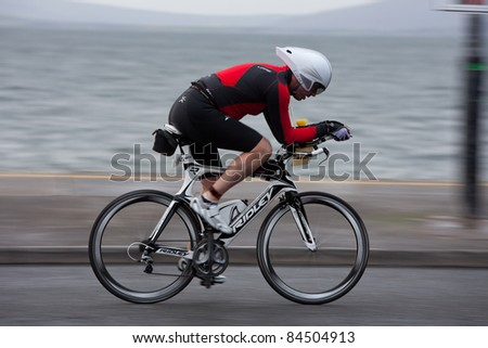 GALWAY, IRELAND - SEPT 4: David Burke (1245) compete at first Edition of Galway Iron Man Triathlon on September 4, 2011 in Galway, Ireland - stock photo