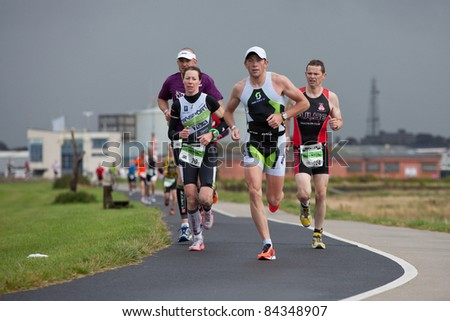 GALWAY , IRELAND - SEPT 4: Joce Wolfe (20), Shane Mccarthy (224) and other athletes compete at first Edition of Galway Iron Man Triathlon on September 4, 2011 in Galway, Ireland - stock photo
