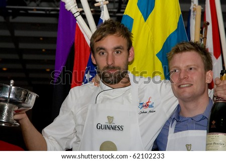 GALWAY, IRELAND - SEPT. 25: Johan Malm (Swedan)-2010 winner the Oyster Opening Championship and Mihael Moran during 56th Galway International Oyster Festival , September 25, 2010 in Galway, Ireland