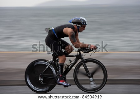 GALWAY, IRELAND - SEPT 4: Mark Brown (1144) compete at first Edition of Galway Iron Man Triathlon on September 4, 2011 in Galway, Ireland - stock photo