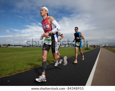 GALWAY, IRELAND - SEPT 4: Mark Samuels (477) competes at first Edition of Galway Iron Man  Triathlon on September 4, 2011 in Galway, Ireland - stock photo