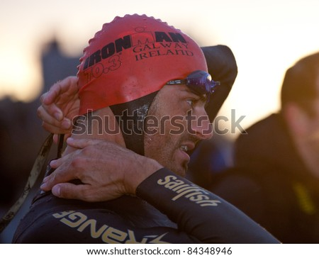 GALWAY, IRELAND - SEPT 4: Mike Aigroz (9), winner, prepares to start at first Edition of Iron Man  Triathlon on September 4, 2011 in Galway, Ireland - stock photo