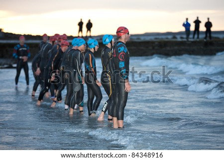GALWAY, IRELAND - SEPT 4: Pro athletes prepare to start at first Edition of Galway Iron Man Triathlon on September 4, 2011 in Galway, Ireland - stock photo