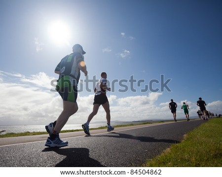GALWAY, IRELAND - SEPT 4: Unidentified athletes compete at first Edition of Galway Iron Man Triathlon on September 4, 2011 in Galway, Ireland - stock photo
