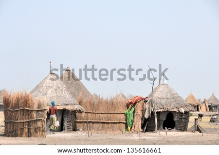 GAMBELA, ETHIOPIA - FEB 9: Villages of the Nuer people in the area of Gambela, close to South Sudan border, typical African huts on Feb 9, 2013 in Gambela, Ethiopia. - stock photo
