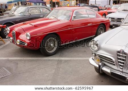 "GAMBETTOLA, ITALY - SEPTEMBER 5: old cars exhibition, vintage italian Alfa Romeo on September 5 2010 in ""Mostrascambio"" of Gambettola, Italy. - stock photo"