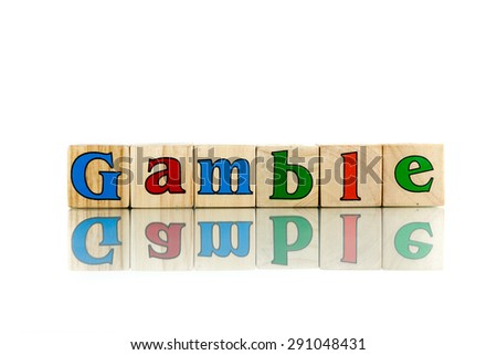 gamble colorful wooden word block on the white background
