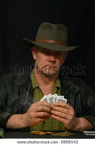 Gambler holding his cards - stock photo