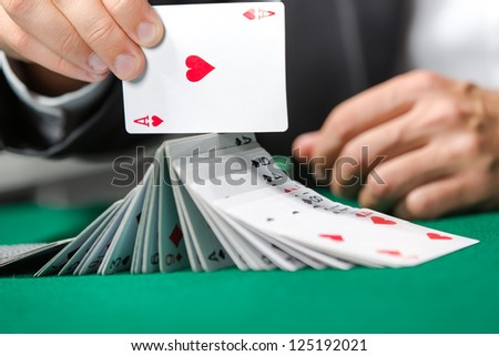 Gambler playing with poker cards. Risky entertainment of gambling - stock photo