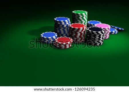 Gambling casino chips stacked on green table. Great background for poker magazines, banners, webpages, flyers, etc. - stock photo