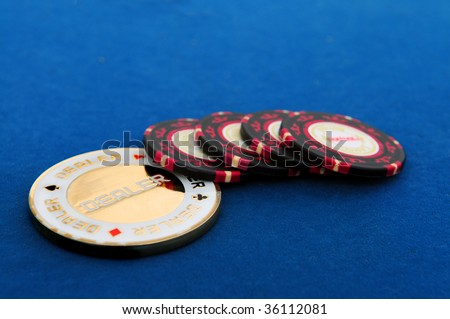 Gambling chips on blue table background - stock photo