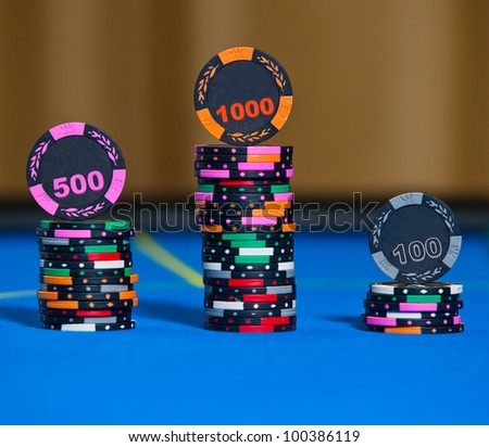 Gambling chips on casino table - stock photo