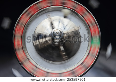 gambling concept detail of  a spinning roulette wheel - stock photo