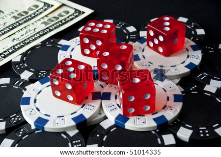 Gambling dice for Casinò games, chips and hundreds dollars