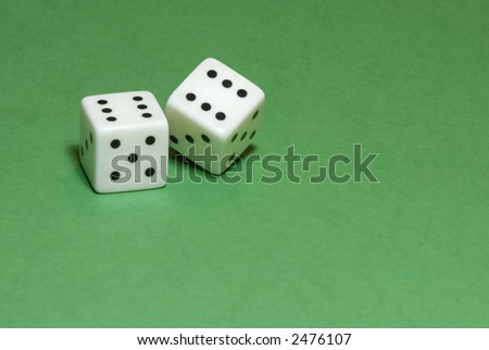 Gambling dices on green casino table background (also available on white or black backgrounds) - stock photo