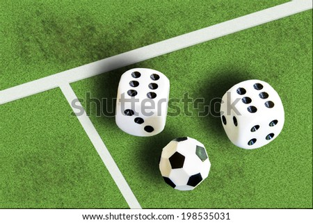 Gambling with dice and football win money - stock photo