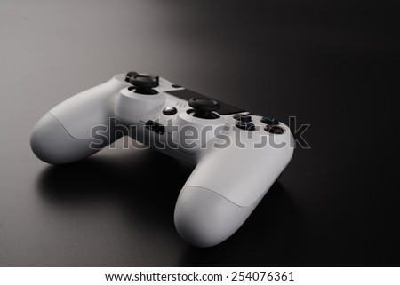 Game controller isolated on a black background - stock photo