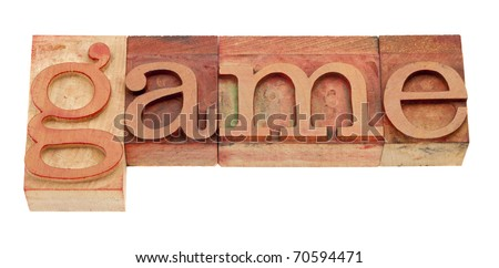 game - isolated word in vintage wood letterpress printing blocks stained by red inks